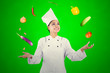 canvas print picture - Beautiful chef juggling food ingredients on studio