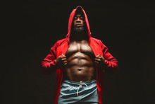Confident African Bodybuilder In Red Hooded Shirt With Bare Chest