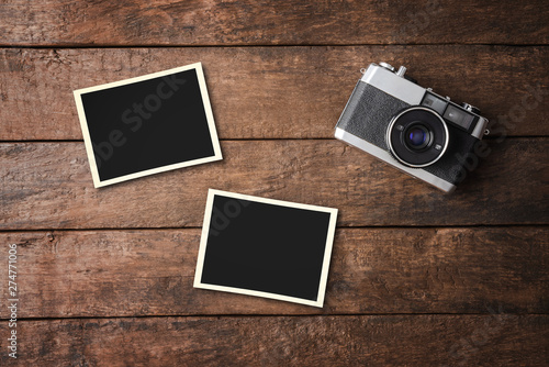 Vintage camera with empty photo frames. Top view