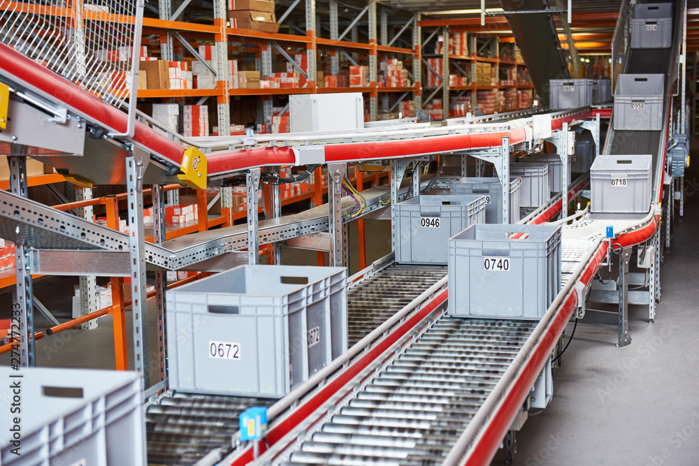 Fototapety, obrazy: Automated warehouse. Boxes with spare parts moving on conveyer