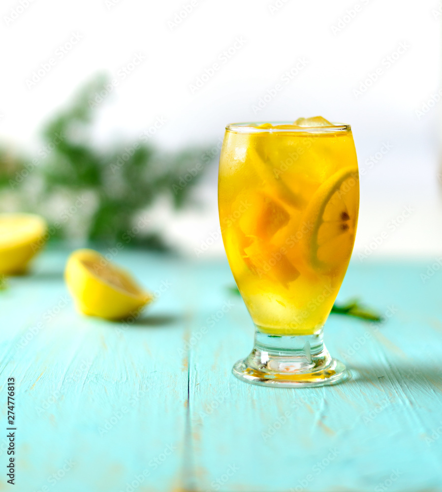 Fototapety, obrazy: Yellow iced tea with pineapple, lemon