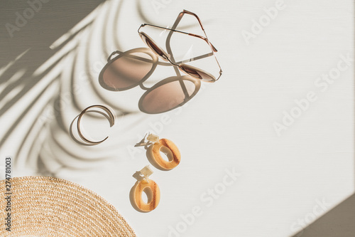 Obraz na płótnie Fashion composition with women's accessories on white background with floral shadow