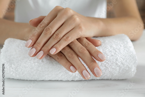 Foto op Aluminium Manicure Woman showing smooth hands on towel, closeup. Spa treatment