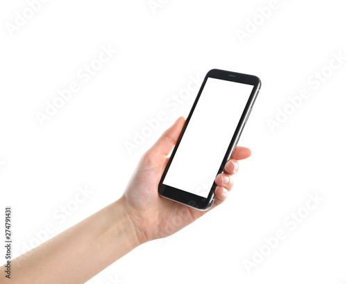 Fotografering  Woman holding smartphone with blank screen on white background, closeup of hand