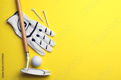 Set of golf equipment on color background, flat lay. Space for text
