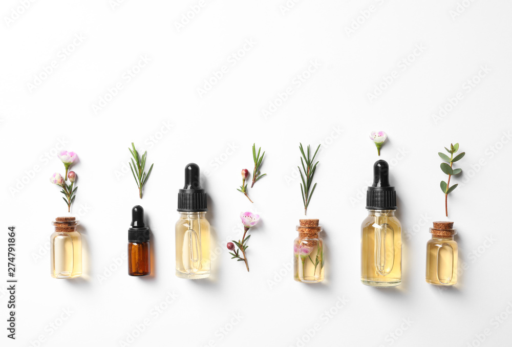 Fototapety, obrazy: Flat lay composition with bottles of natural tea tree oil on white background