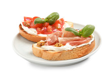 Plate With Tasty Bruschettas On White Background
