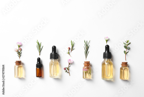 Canvas Prints Countryside Flat lay composition with bottles of natural tea tree oil on white background