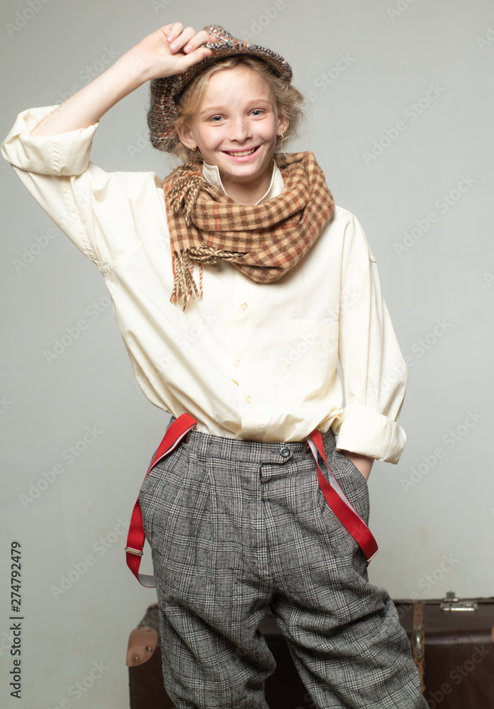 Fototapety, obrazy: teen girl in retro male suit. retro fashion model. Vintage suspender. old fashioned child in beret. street kid with dirty face. vintage english style. Travel with old suitcase. Homelss. traveling