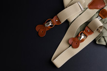 Male Suspenders With Leather Details On Black Background With Copoy Space. Hipster Style Concept