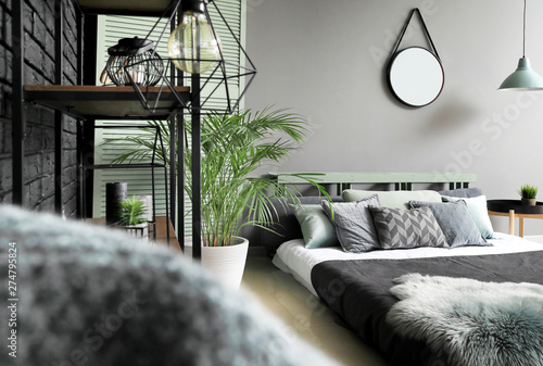 Beautiful interior of modern stylish bedroom