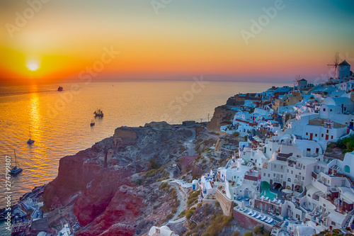 Foto auf Leinwand Orange Group of Romantic Sailing Boats At Santorini Island in Greece. Waiting for Sunset.
