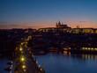 Evening view of Prague Castle, Charles Bridge and the Vltava in Prague, Czech Republic.