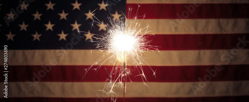 Lit sparkler in front the American Flag for 4th of July celebration - 274803690