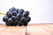 I Photographed A Big Grape On A Board With A White Background.