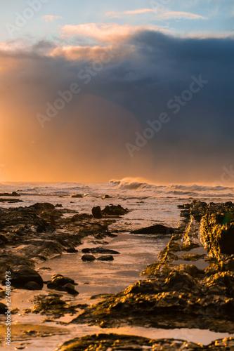 Printed kitchen splashbacks Coast Waves and Rocks at Beach at Sunrise