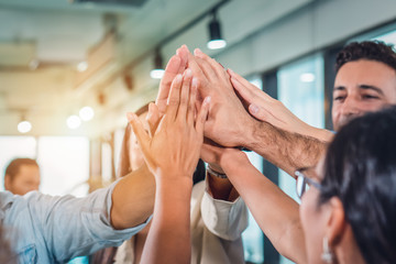 business people teamimg up and making highfive to cheer up team spirit