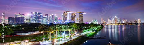 SINGAPORE, SINGAPORE - MARCH 2019: Vibrant Singapore skyline with Marina Bay Sands, Gardens by the bay with cloud forest, flower dome and supertrees at sunset Wallpaper Mural
