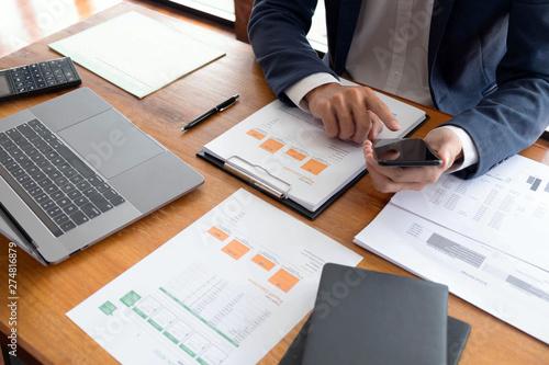 Fototapeta Businessmen, finance, accounting work, checking accounts, using calculators and finding information obraz na płótnie
