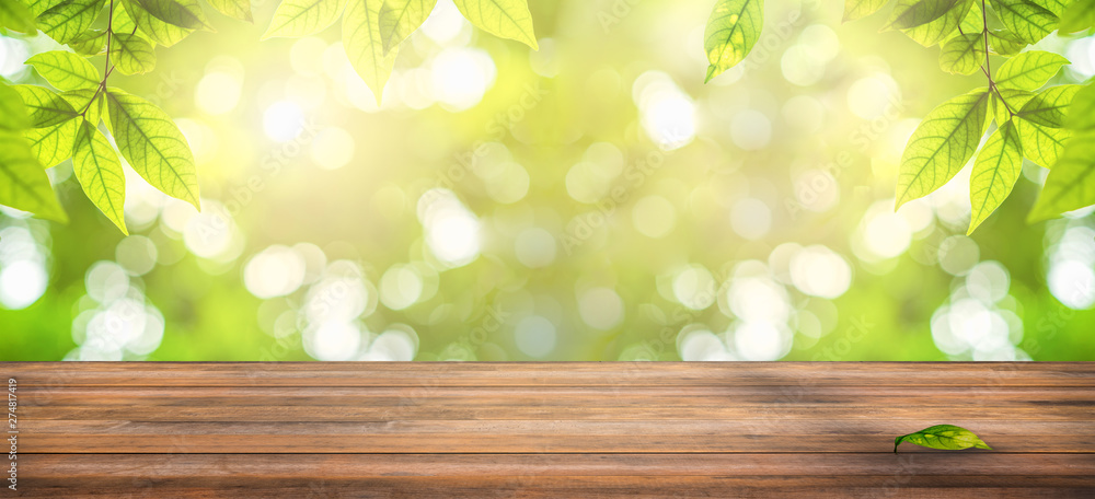 Fototapety, obrazy: wooden table with natural view of green leaves in garden, ray of sunlight though tree leaves in summer time