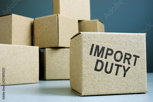Foto Import duty concept. Pile of cardboard boxes.