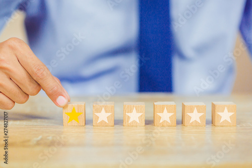 Fotografia, Obraz customer pressing star on wood cube, Service rating, satisfaction concept