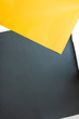 Top down view of yellow and grey photographic paper backgrounds.