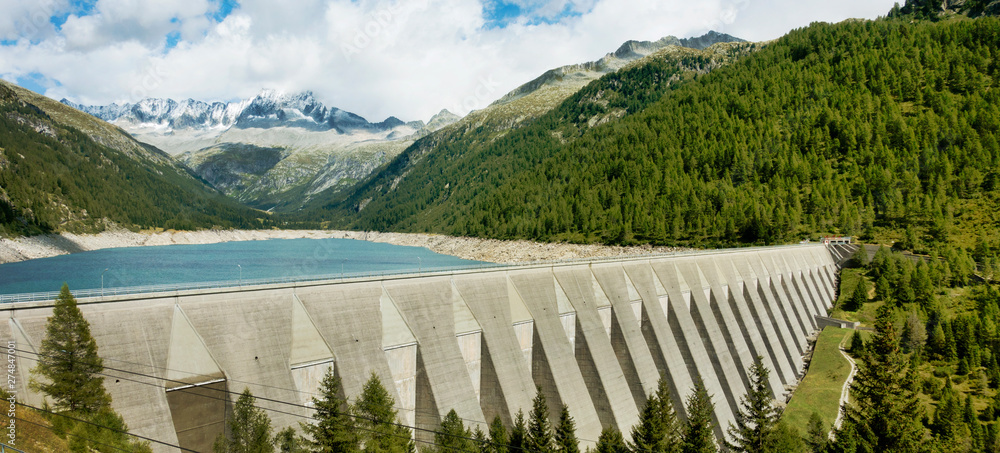 Fototapety, obrazy: Big concrete dam with scenery of lake, forest and high mountains.