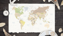 Map Of The World On Old Paper Surrounded By Compass, Anchor, Lifebelt And Shells.