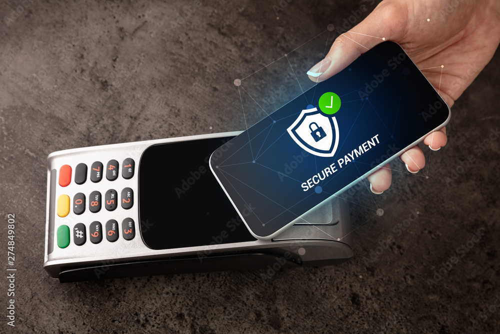 Fototapety, obrazy: Hand paying on terminal with smartphone in secure payment system
