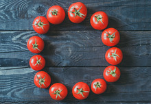Circle Formed With Freshly Picked Tomatoes On Dark Rustic Wooden Background