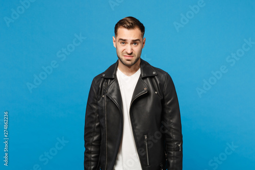 Young Sad Frustrated Worried Unshaven Man In Black Jacket