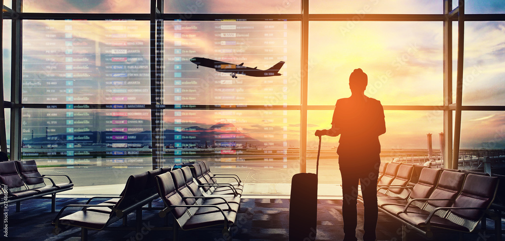 Fototapeta Silhouettes passenger airport. Airline travel concept.