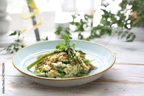 Risotto with spinach and green asparagus. Appetizing dish Wallpaper Mural