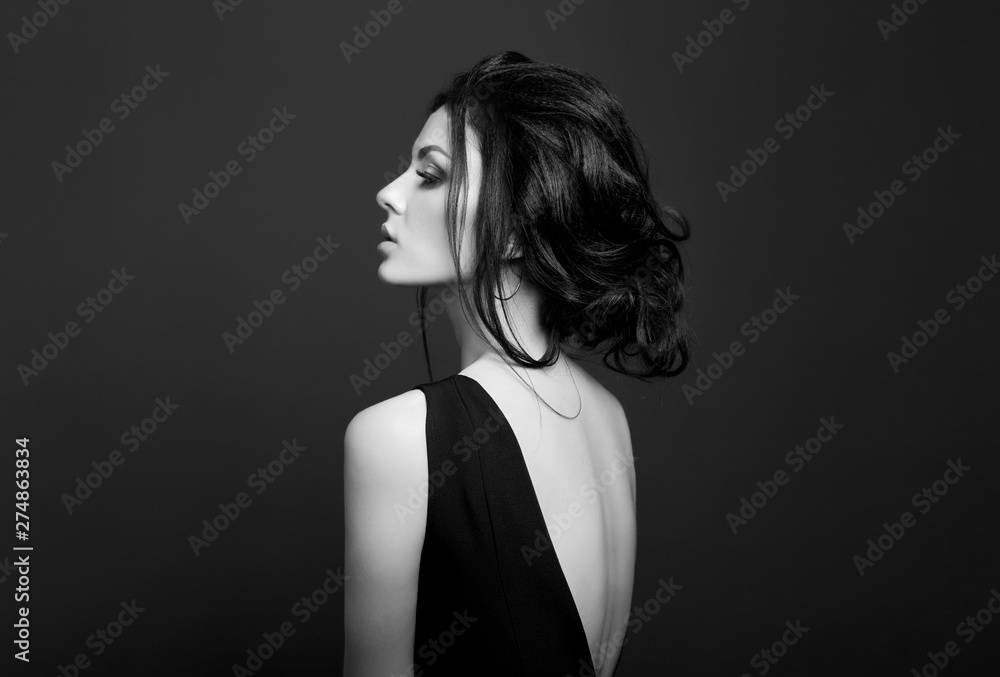 Fototapeta Classic Smokey makeup on woman face, beautiful big eyes. Fashion Perfect makeup, expressive eyes on girl face, smooth black eyebrows, licked brunette hair. Portrait of a woman on a dark background