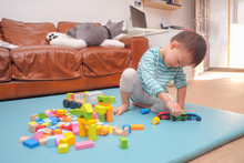 Cute Little Asian 2 - 3 Years Old Toddler Boy Child Having Fun Playing With Wooden Building Block Toys Indoor At Play School / Nursery / Daycare / Home, Educational Toys For Young Children Concept