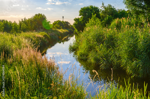 Canvas Print Blue sky over a little creek in the surrounding countryside of Berlin, Germany
