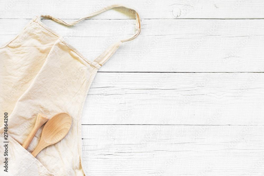Fototapeta White wooden background with light linen apron