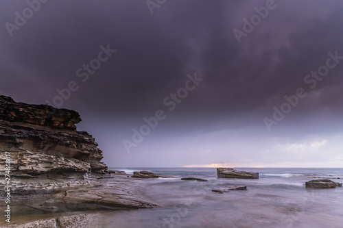 Fototapeta Overcast and Drizzly Rocky Seascape