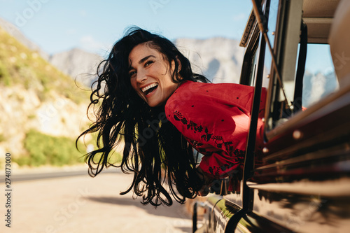 Woman having a great time on road trip