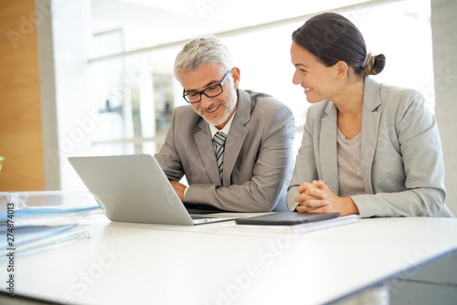 Corporate business coleagues working together in modern office