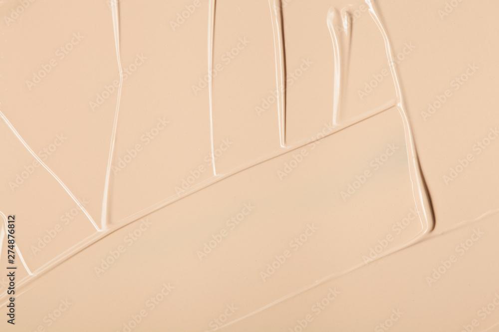 Fototapeta Close up of face liquid foundation texture.