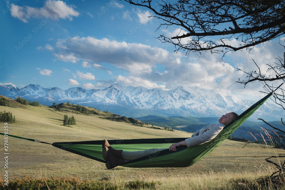Fototapety, obrazy: Woman resting in hammock outdoors. Sleeping outdoors.