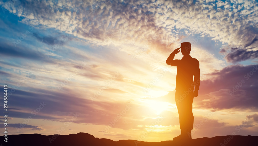 Fototapeta Soldier saluting at sunset. Army, salute, patriotic concept.