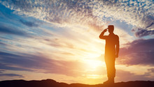 Soldier Saluting At Sunset. Ar...