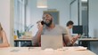 Happy business man talking phone at coworking space. Young guy having phone