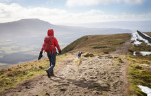 A Hiker Walking Down From The Summit Of Whernside, Part Of The Three Peaks In The Yorkshire Dales, England.