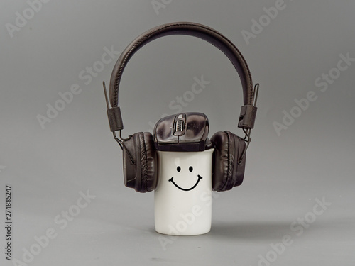 headphones cup and mouse. stylized music lover on a gray background. - 274885247
