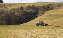 A Tractor In A Field At A Farm Near Horton In Ribbleshead In The Yorkshire Dales.