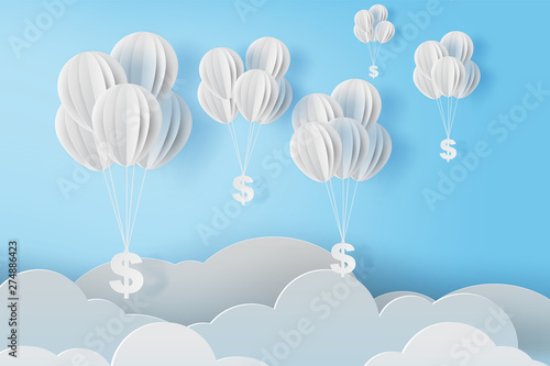 Photo  illustration of balloon fly with dollar sign on blue sky
